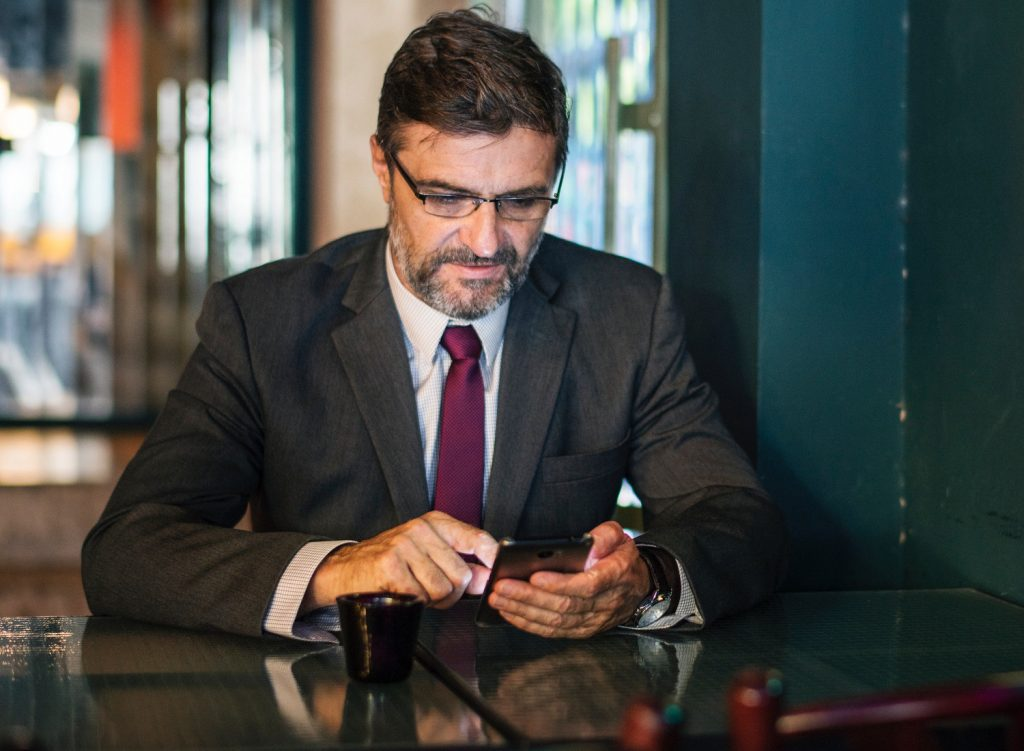 Man in suit looking at cellphone
